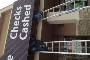 Window cleaner cleaning awnings