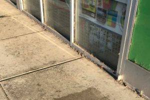 Dirty sidewalk on storefront