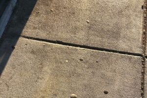 Dirty sidewalk on storefront