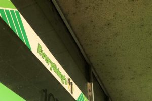 Dirty eaves on storefront