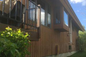 Clean windows on a cabin